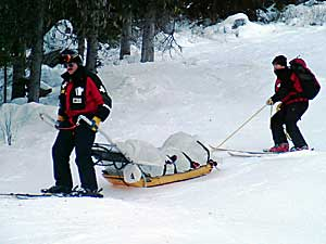 Mike Henness being take down in a sled by ski patrol at Sun Peaks, Canada, Dec. 2005.